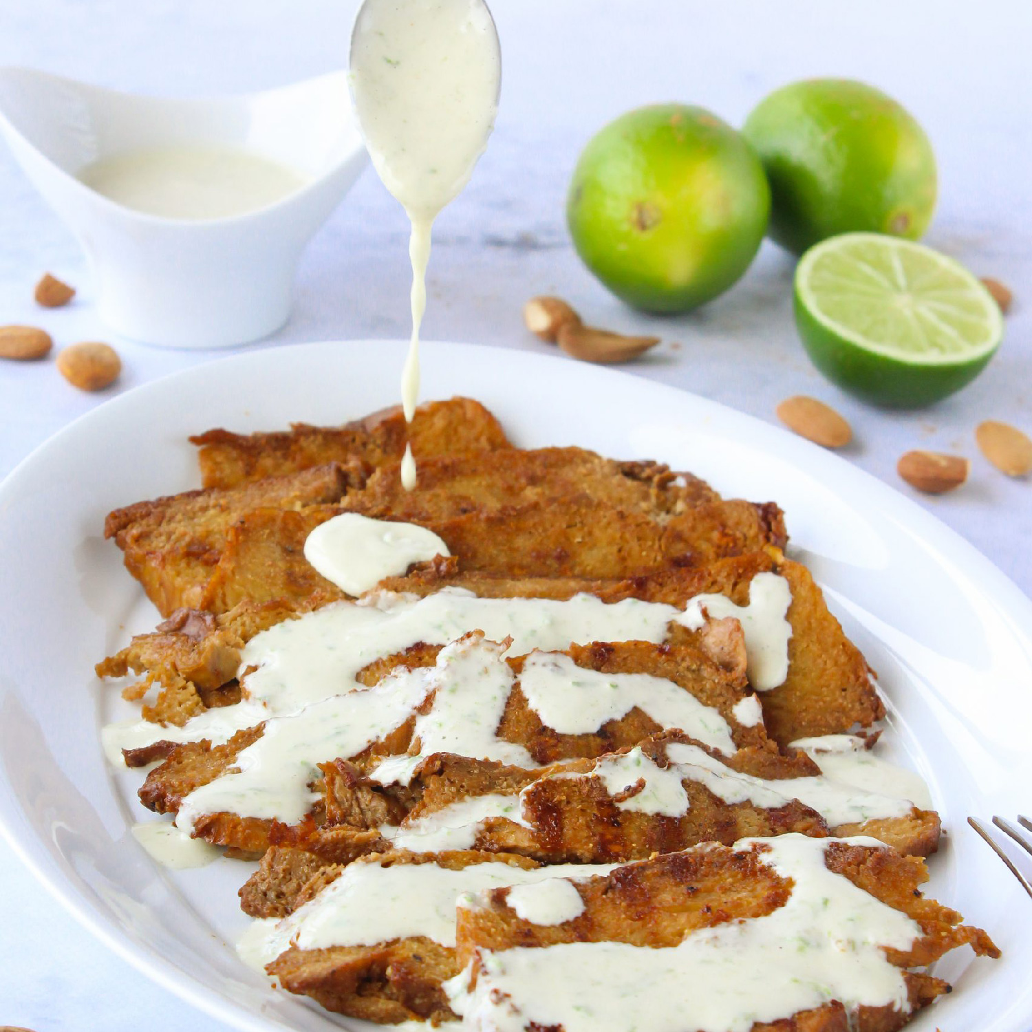 Seitan steaks with almond and lime sauce